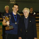 Sasha Dimitric presents the Sasha Dimitric Cup to NSW Men's captain, Christoph Niebel.